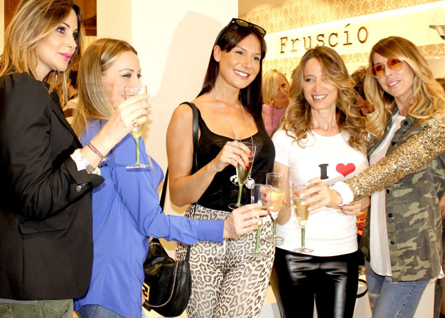 Cristina Mariani, titolare e stilista del brand Fruscio, Nicole Minetti, testimonial della griffe, Simona Salvemini e Guendalina Canessa