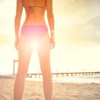 gambe sole abbronzante