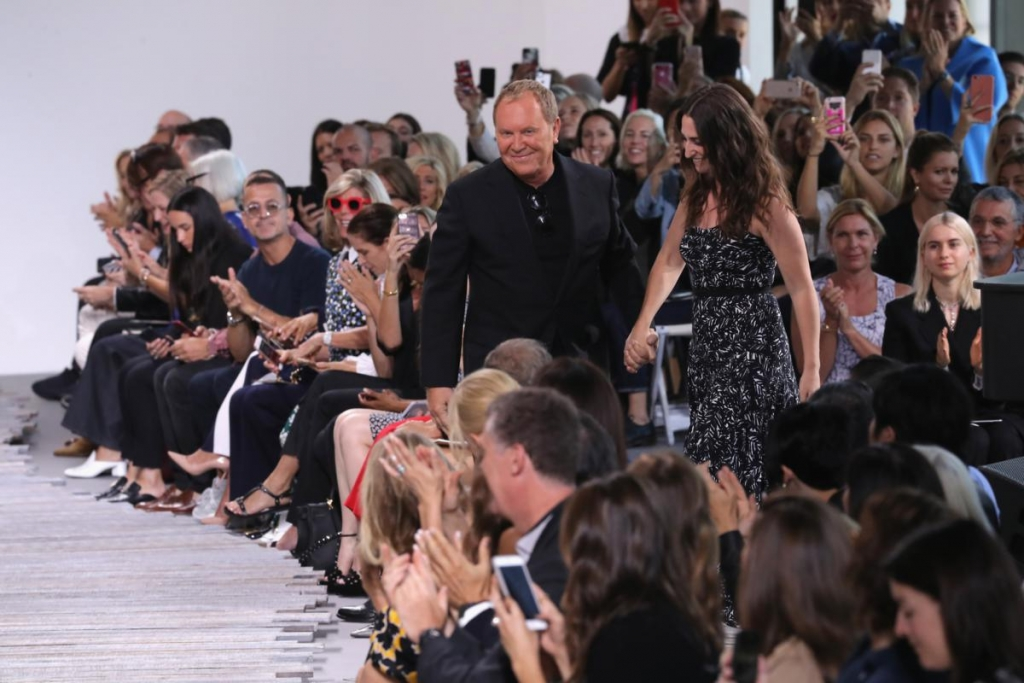 NEW YORK, NY - SEPTEMBER 13:  Michael Kors and Sara Bareilles walk the runway for the Michael Kors Collection Spring 2018 Runway Show at Spring Studios on September 13, 2017 in New York City.  (Photo by JP Yim/Getty Images for Michael Kors)