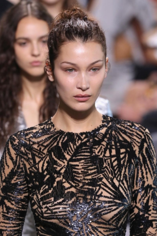 NEW YORK, NY - SEPTEMBER 13:  Bella Hadid walks the runway for Michael Kors Collection Spring 2018 Runway Show at Spring Studios on September 13, 2017 in New York City.  (Photo by JP Yim/Getty Images for Michael Kors)